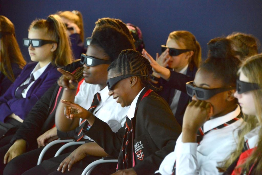 The students participate in a 3D visualisation demonstration in one of our visualisation suites.